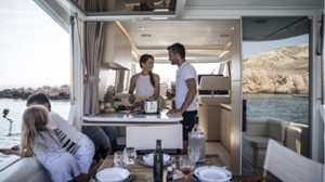 electric charter boat interior with family