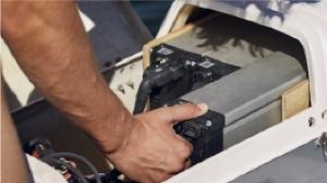 electric hydrofoiling catamaran battery slides in underneath steering wheel