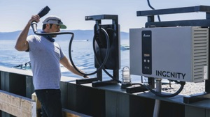 Man with Ingenity Electric Boat Compressor Ready to Plug Into Electric GS22E