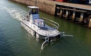electric boat with two 'pincers' in front of the bow to collect floating garbage