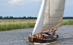 Sailboats sailing in The Broads area of England
