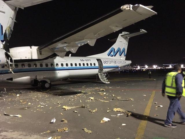 Aviones chocan en AICM; uno estaba estacionado