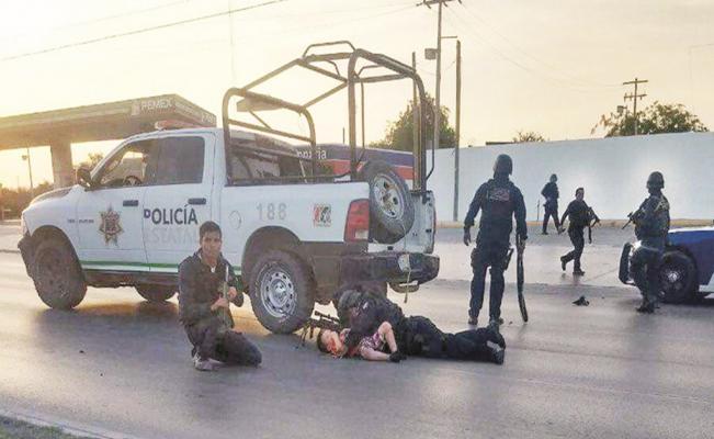 Federales protegen a niño en plena balacera en Nuevo Laredo