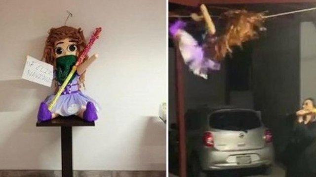 Foto en la que un grupo de abogados y psicologos rompieron una piñata feminista en un despacho de abogados