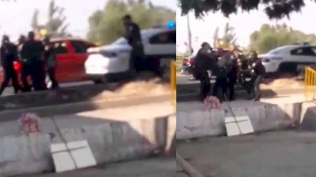 Policías forcejean y se les escapa un tiro. (Foto: Publimetro)