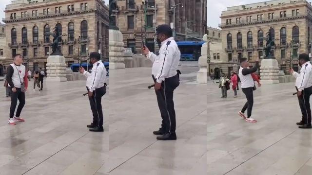 Policía camarógrafo de un peatón