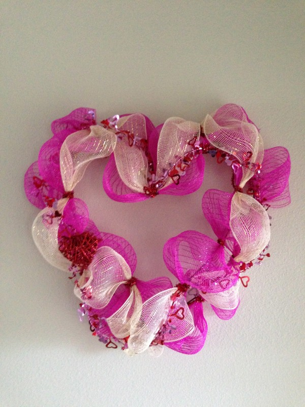 I am going to show you just how easy it is to make a Valentine's Day Deco Mesh Wreath and if I can do it, anybody can! Once you try it, you won't stop!