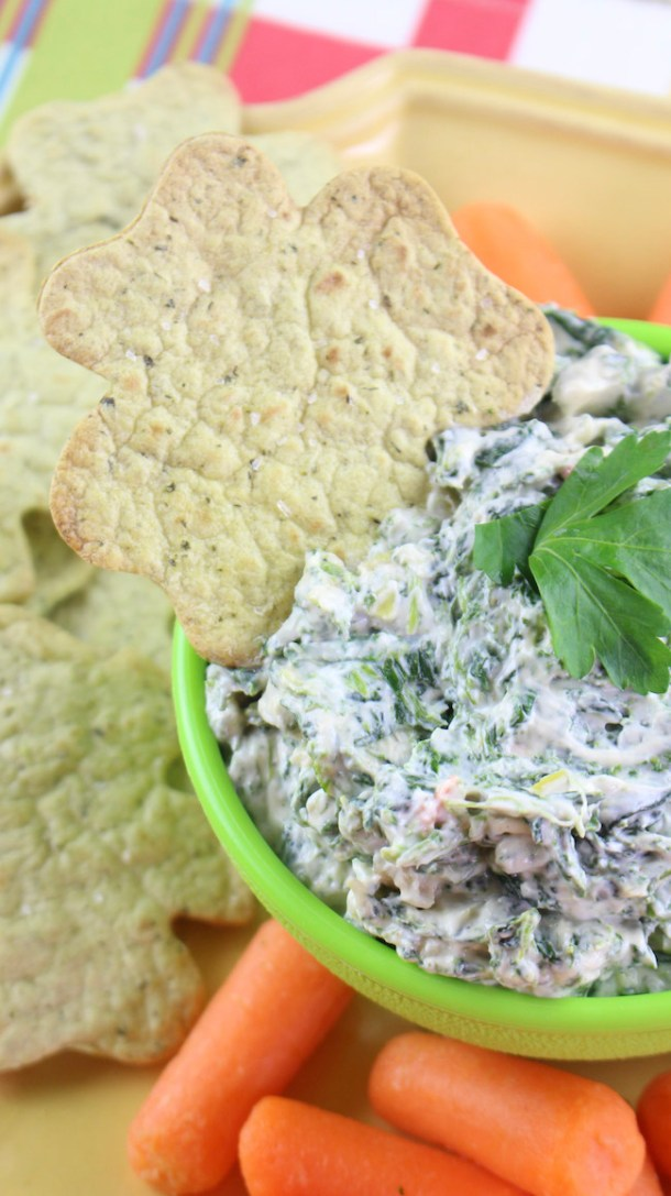 Who doesn't love Spinach dip? But you don't like love the calories. Thank goodness for Skinny Spinach Dip with Baked Shamrock Chips Recipe.
