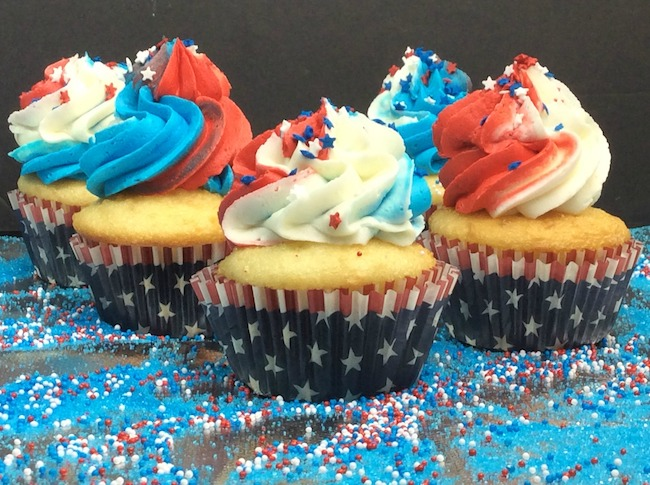 ake your cooled cupcake and frost it. Top with star or sprinkles right away.