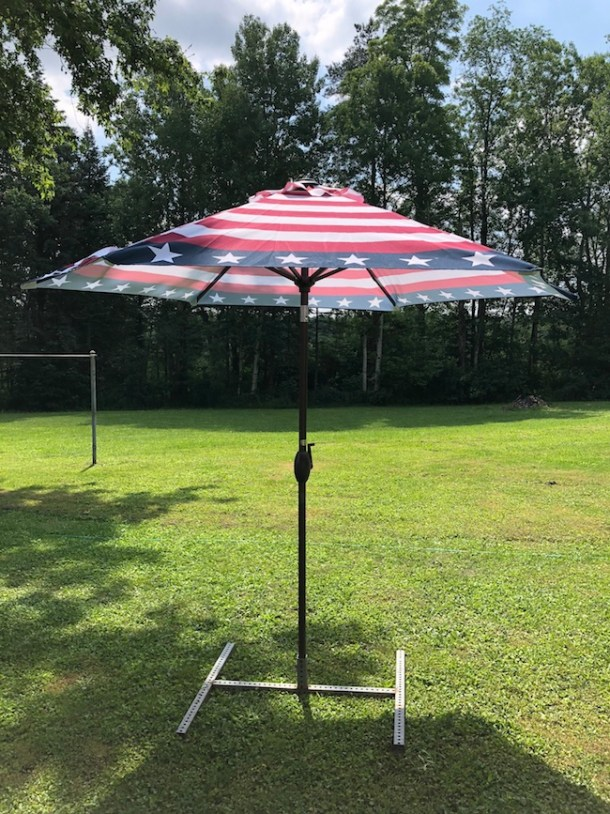TheOutdoor Patio Umbrella made by Abba Patio and is 9 feet in diameter where you can fit your 42 - 54 inch table under with 4 to 6 chairs.