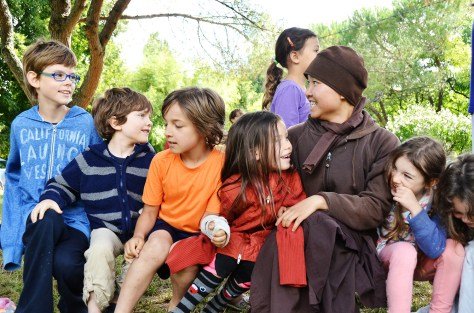 Young nuns practising playful mindfulness with children during the summer retreat