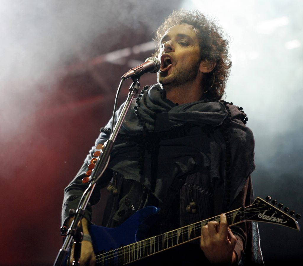 """Gustavo Cerati of Argentina's rock group Soda Stereo performs during the first concert of the 2007 Tour """"Me Veras volver"""" at the Monumental stadium in Buenos Aires, October 19th, 2007. Soda Stereo began tonight a twenty-one-concert tour across the American continent.  AFP PHOTO/Juan MABROMATA ARGENTINA-MUSIC-SODA STEREO ARGENTINA-MUSIC-SODA STEREO ARGENTINA-MUSIC-SODA STEREO ARGENTINA-MUSIC-SODA STEREO"""