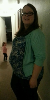 I am 30 weeks in the photo. I love how my daughter is photo bombing down the hallway. The picture makes me feel strong and beautiful. Honestly I feel so much prettier when pregnant. It rounds out my rolls and allowed me to wear stretchy pants and more form fitting tops. Rebecca McKinney