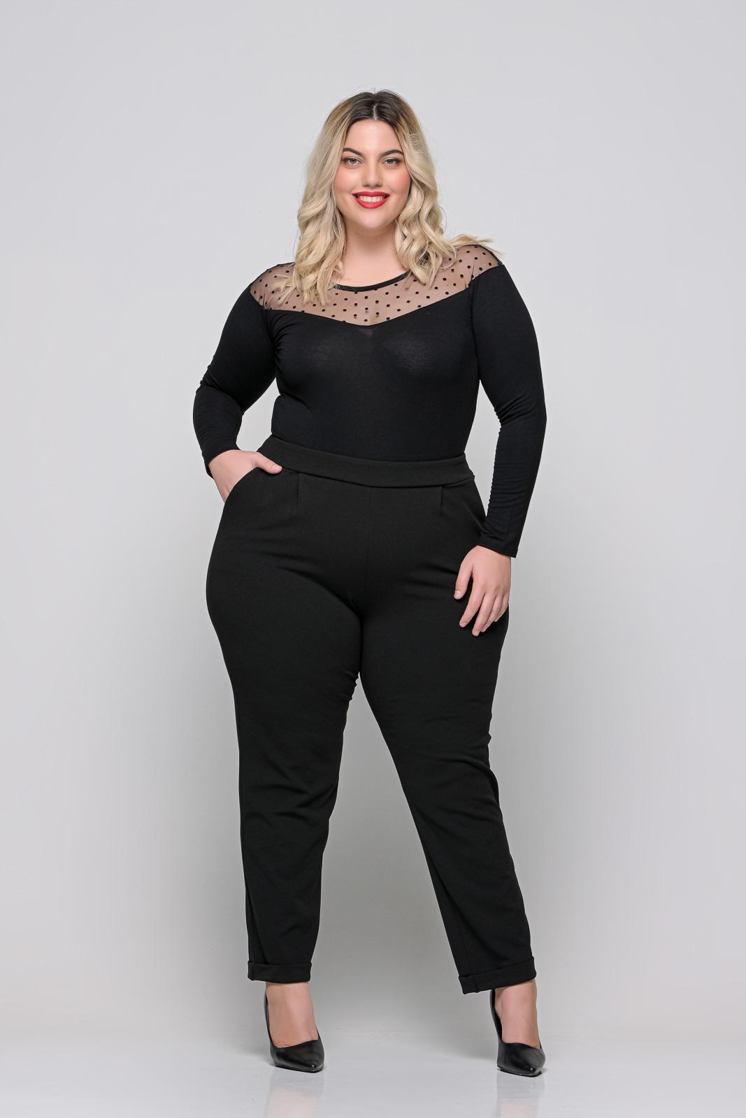 Κορμάκι μεγάλα μεγέθη μαύρο με πουά διαφάνεια στους ώμους.Στο eshop μας θα βρείτε οικονομικά γυναίκεια ρούχα σε μεγάλα μεγέθη και υπερμεγέθη.