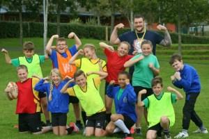 James Penman coaching school children