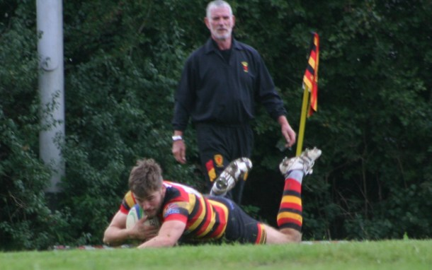 Saltash's Will Morton dives over for the winning try