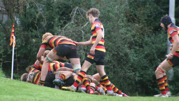 Saltash's players jump on Will Morton after he wins the game for them with the last play of the game