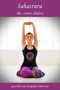 woman in tank top with sahasrara chakra design