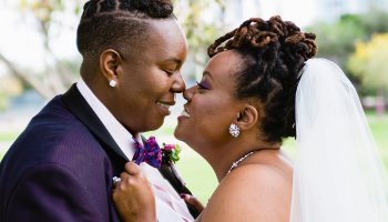 Same sex couple share an intimate moment at their Ellis-Shackelford House wedding by Arizona wedding photographer PMA Photography.