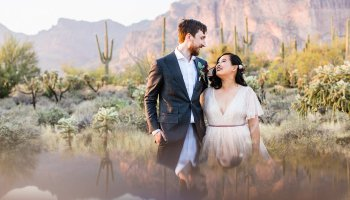 Bride and Groom pose during their Superstition Mountain Cloth and Flame wedding by Arizona wedding photographer PMA Photography.