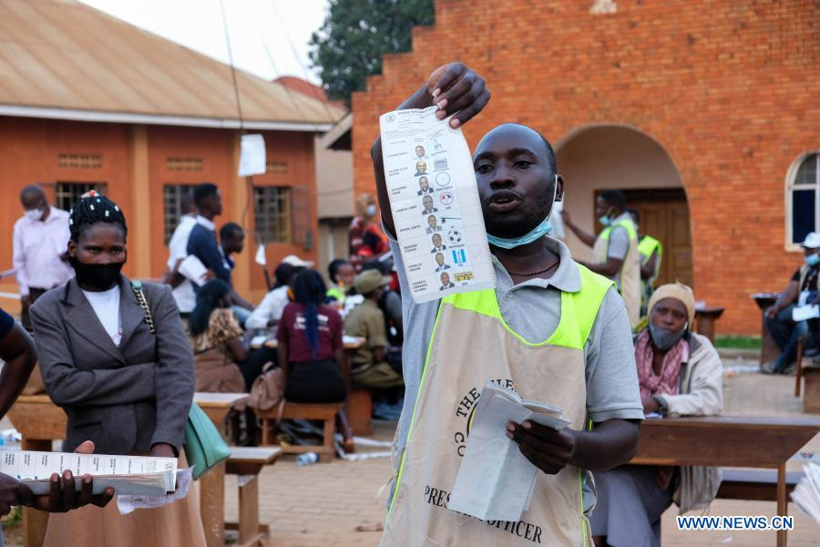 A staff member displays a ballot at a polling station in Najjera, Wakiso District, Uganda, on Jan. 14, 2021. Vote counting in Uganda's Thursday presidential and parliamentary elections has started with the country's electoral body saying results are expected to be released in 48 hours. (Photo by Hajarah Nalwadda/Xinhua)
