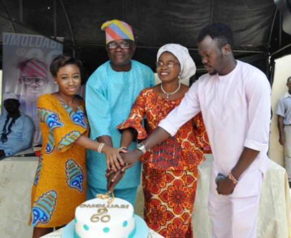 Mr Yomi Layinka being assisted by his wife, Bisi and children  Olufela and Niniola to cut his 60th birthday  in Ibadan…