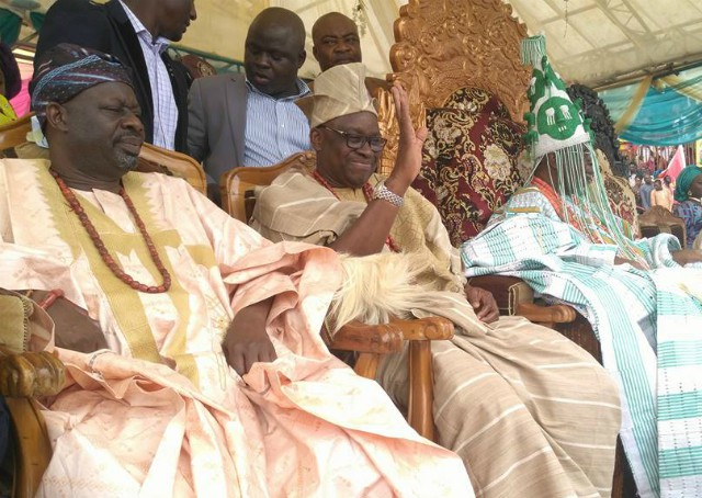 Governor Ayodele Fayose, middle, with Oba Rufus Adeyemo Adejugbe, right...during the festival on Saturday...