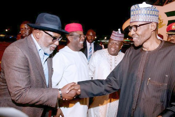 President Muhammadu Buhari, right, with Governor Oluwarotimi Akeredolu of Ondo State with others...