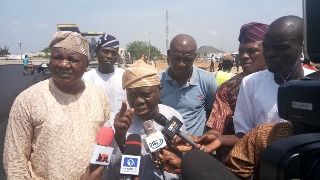 L-R: Commissioner for Works and Transport, Engr. Kazeem Salami and Commissioner for Information and Strategy, Mr Adelani Baderinwa answering questions from journalists while inspecting the Oba Adesoji Aderemi (Osogbo East Bypass) on Friday…