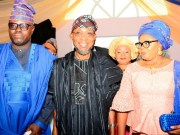 Governor Rauf Aregbesola, middle, with Mr and Mrs Semiu Okanlawon at the birthday carnival...