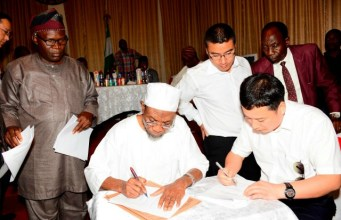 Governor of Osun, Ogbeni Rauf Aregbesola (2nd left), General Manager Jiangsu Wuxi Taihu Cocoa Food Company Limited, Liu Jianhui (right), Interpreter, Yan Kai (3rd right), Comissioner for Commerce, Industries and Cooperatives, Mr Ismaila Jayeoba Alagbada (left) and Coordinating Director, Ministry of Commerce, Industries and Cooperatives, Mr. Abimbola Osho, during the signing of agreement…