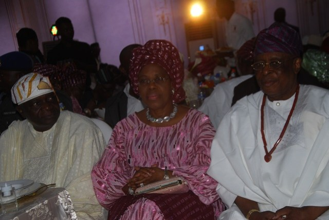 L-R: A former Governor of Osun State, Chief Olagunsoye Oyinlola; Wife of a former Governor of Ogun State, Chief Derin Osoba; and her husband, Aremo Olusegun Osoba, at the reception