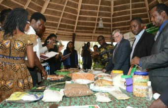 R-L: GCP21 Director Designate, Prof. Malachy Akoroda; GCP21 Conference Communication Coordinator, Godwin Atser; GCP21 Director, Dr Claude Fauquet; and journalists during the exhibition of cassava products in Lagos…
