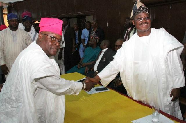 L-R: Chairman, Oke 'Badan Local Council Development Area, Oyo State, Chief Samuel Ajadi; and state Governor, Senator Abiola Ajimobi, during the inauguration of newly-elected