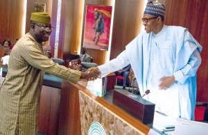 Former Minister of Solid Minerals, Dr Kayode Fayemi, left, with President Muhammadu Buhari...