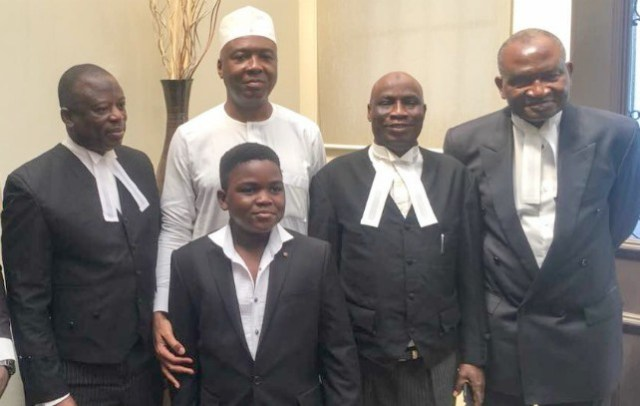 President of the Senate, Dr. Abubakar Bukola Saraki with the leader of his defence team, Chief Kanu Agabi SAN (right), Barr. Saka Isau SAN (2nd right), Mahmud Magaji SAN (left), and Agabi's son, Eshen, shortly after the judgement of the Supreme Court in Abuja, on Friday...