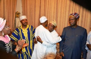 Governor of Osun State, Ogbeni Rauf Aregbesola, congratulating the Governor Elect, Alhaji Gboyega Isiaka Oyetola (Aka Ileri Oluwa). With them are Deputy Governor Elect, Dr. Benedict Gboyega Alabi (right); Deputy Governor Titi Laoye-Tomori and the Oluwo of Iwoland, Oba Abdul-Rasheed Adewale Akanbi, after the declaration of Oyetola…