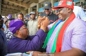 Chief Adebayo Adelabu, right, with his closest rival at the contest, Olasunkanmi Tegbe...at the Adamasingba Stadium...