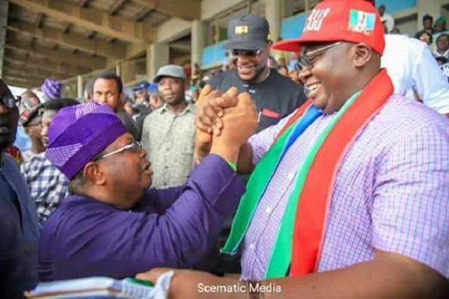Chief Adebayo Adelabu, right, with his closest rival at the contest, Olasunkanmi Tegbe...at the Adamasingba Stadium...
