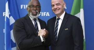 NFF's Amaju Pinnick, left, with FIFA Boss...