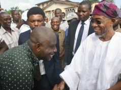 Governor State of Osun, Ogbeni Rauf Aregbesola (right) and one of the deceased comedian's children, Mr Muyiwa Adejumo during the visit…