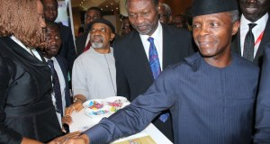 Vice President Yemi Osinbajo, right, with others at the stand of Stanbic IBTC...