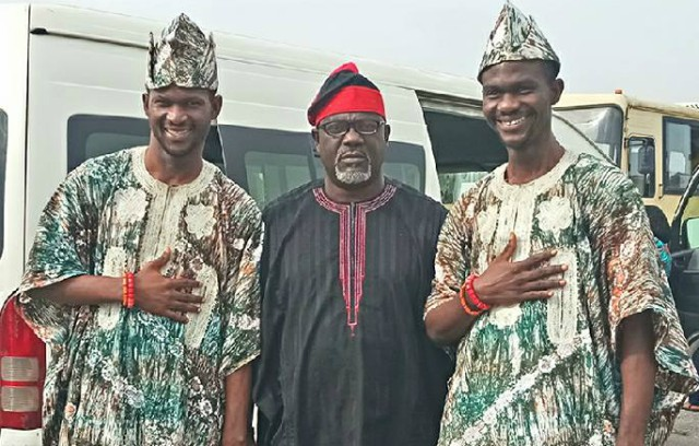 Oyo State's Commissioner for Information, Culture and Tourism, Mr Toye Arulogun with a popular set of twins at the event...
