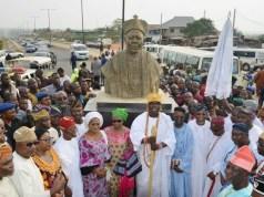 From right…front row, Osun's outgoing governor, Ogbeni Rauf Aregbesola; the eldest son of the former Civilian Governor Western Region of Nigeria, Prince Ishola Aderonmu Adesoji; the Ooni of Ife, Oba Adeyeye Enitan Ogunwusi; Eldest child of Chief Obafemi Awolowo, Chief (Mrs) Tola Oyediran; deputy governor Titi Laoye-Tomori; governor-elect, Mr. Gboyega Oyetola; his deputy, Mr. Benedict Gboyega Alabi and others, during the commissioning of Oba Adesoji Aderemi Way, named after the former Civilian Governor along ring road, Osogbo on Monday…