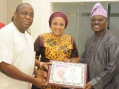 L-R: Dr Seye Kehinde, Dr (Mrs) Florence Ajimobi and her husband, Senator Abiola Ajimobi...during the presentation of the award...