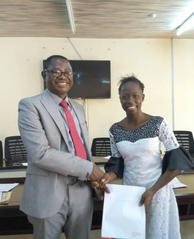 Professor Ayobami Salami presenting a letter of award to Miss Adedamola Adegoke, one of the pioneer beneficiaries of the Josephus Foundation Scholarship on Tuesday…