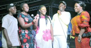 Engineer Seyi Makinde, his wife and children...singing at the event...