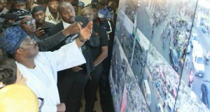 L-R: Oyo State Governor, Senator Abiola Ajimobi; Chairman, Oyo State Security Trust Fund/All Progressives Congress governorship candidate, Chief Adebayo Adelabu; and a Security Expert, Mr Francis Anyaebosi, during the inauguration of Phase One of the Safe City Control Centre, in Ibadan...