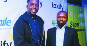 Uche Okafor – Country Manager, W/Africa at TaxifyNigeria in a handshake with Gbolahan Thomas – Head, Legal & Corporate Services at Smile Nigeria signposting the partnership between Smile and Taxifyto to boost Driver and Rider Trip Experiences with 4G LTE Mobile Connectivity…