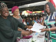 Governor Abiola Ajimobi, left, with his wife, Florence...as he gives Modupe Fehintola of BCOS her well-deserved award...